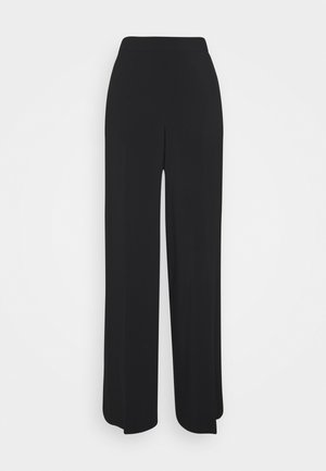 EDDA - Trousers - black