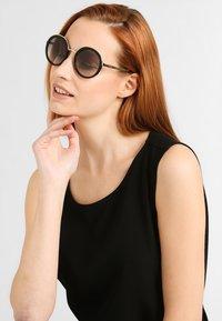 Prada - Okulary przeciwsłoneczne - black - 0