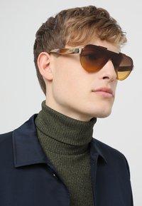Prada - Sonnenbrille - yellow/brown - 1