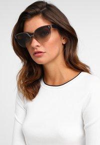 Prada - Sonnenbrille - opal brown - 1