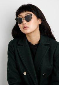 Prada - Sunglasses - pale gold-coloured/black - 1
