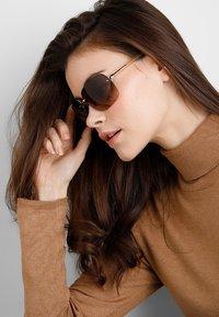 Prada - Sonnenbrille - gold/brown - 1