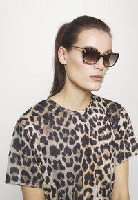 Prada - Sunglasses - mottelt brown - 1