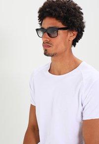 Prada - Sluneční brýle - black/grey gradient - 1