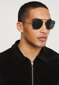 Prada - Sonnenbrille - black/gunmetal/grey - 1