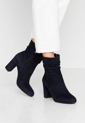 Kotníkové boty - river