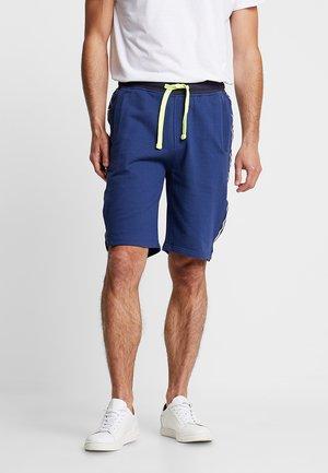 Pantaloni sportivi - dark capri