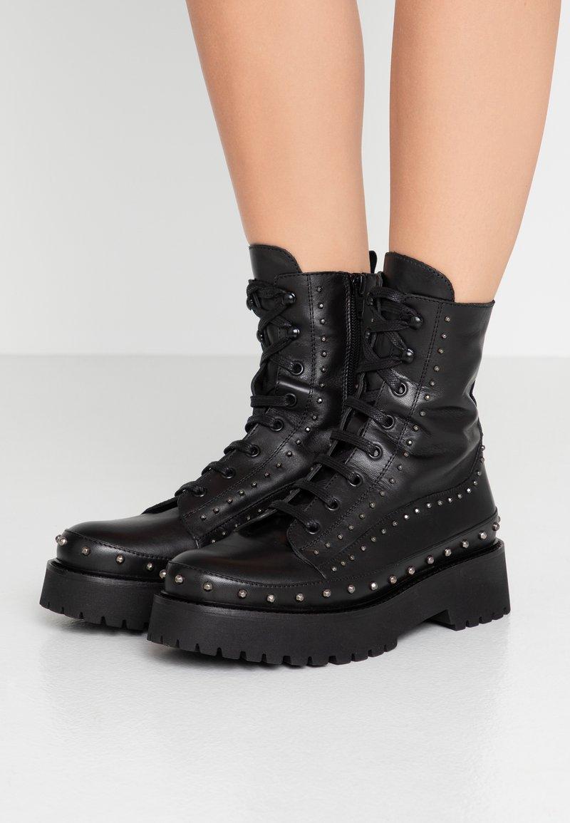 Pinko - CINGOLI - Cowboy/biker ankle boot - black
