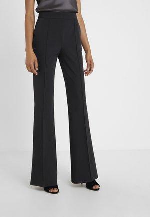 RASSICURARE PANTALON - Trousers - black