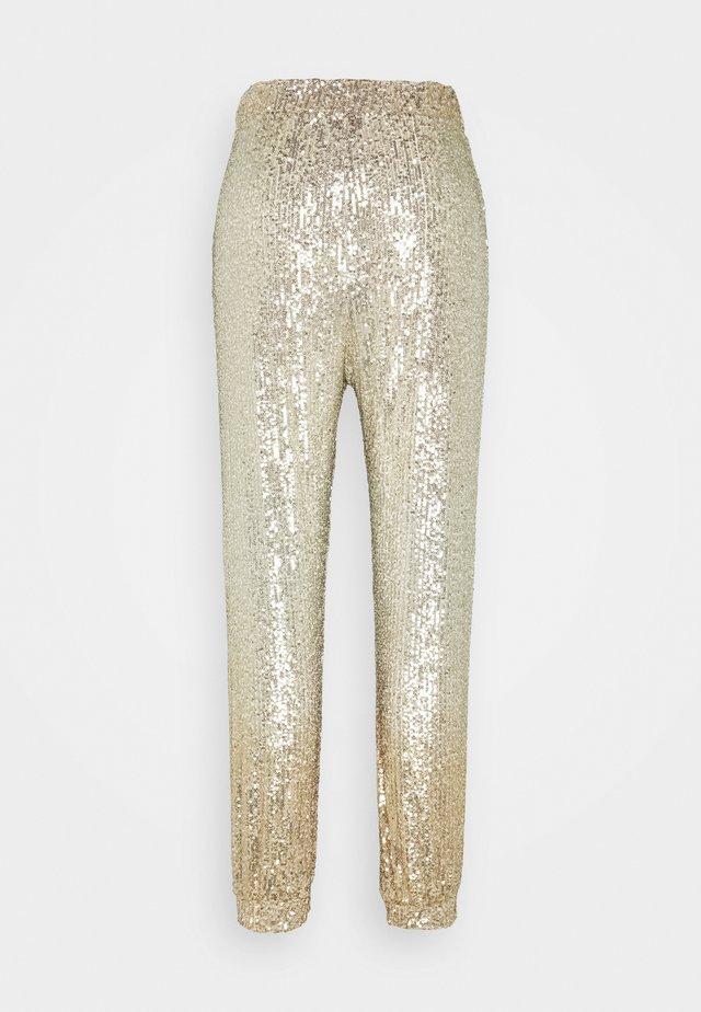 ANNUNZIARE  - Pantaloni - gold