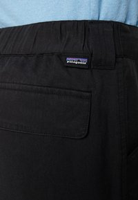 Patagonia - EDGE WIN JOGGERS - Trousers - ink black - 5