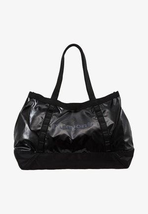 BLACK HOLE TOTE 25L - Sports bag - black