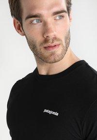 Patagonia - LOGO RESPONSIBILI TEE - T-shirt med print - black - 3