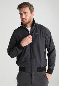 Patagonia - BAGGIES - Outdoor jacket - ink black - 0