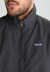 Patagonia - BAGGIES - Outdoor jacket - ink black - 5