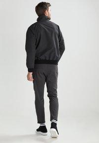 Patagonia - BAGGIES - Outdoor jacket - ink black - 2