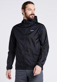 Patagonia - HOUDINI - Outdoorová bunda - black - 0