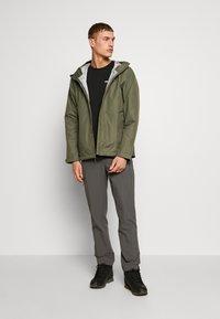 Patagonia - TORRENTSHELL - Hardshell jacket - industrial green - 1