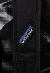 Patagonia - BLACK HOLE DUFFEL 40L - Sports bag - black - 10