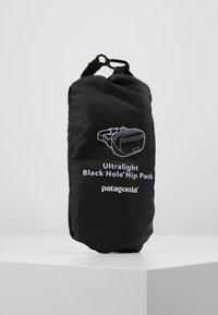 Patagonia - ULTRALIGHT BLACK HOLE MINI HIP PACK - Bältesväska - black - 5