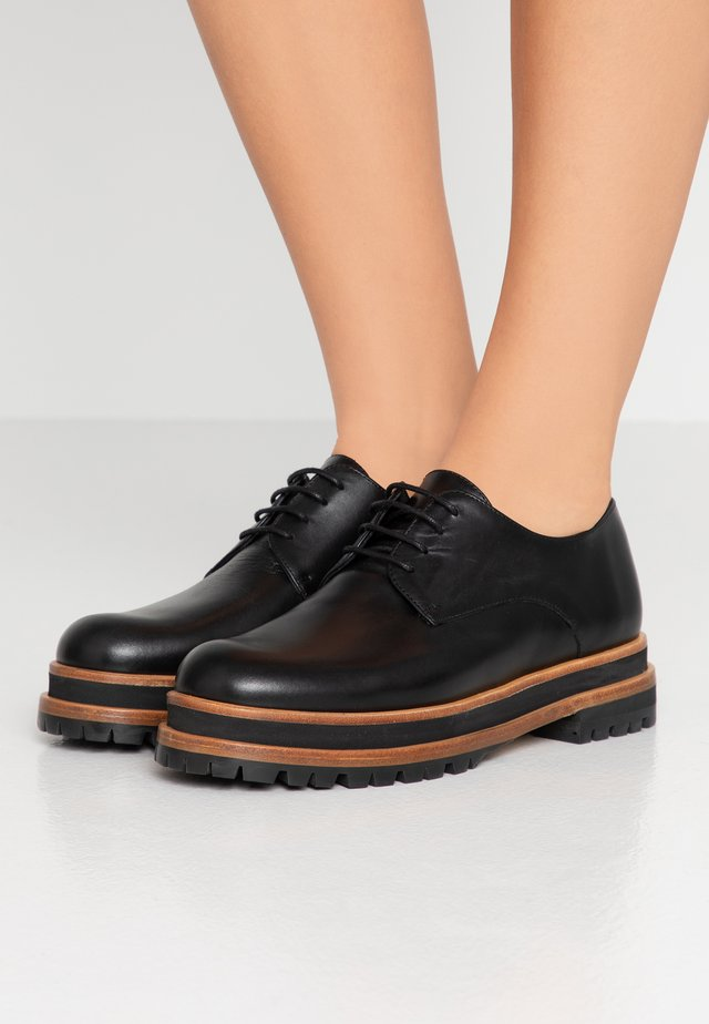DAGNY - Lace-ups - black