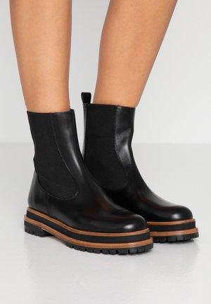 DALE  - Platform ankle boots - black