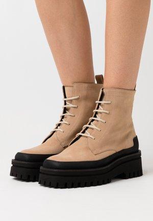 ALCOBACA - Platform ankle boots - beige