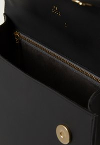 PB 0110 - Taška spříčným popruhem - black - 2