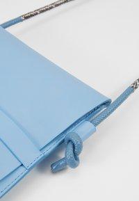 PB 0110 - Taška spříčným popruhem - baby blue - 5