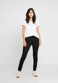 Opus - LEVINA - Spodnie materiałowe - black - 1
