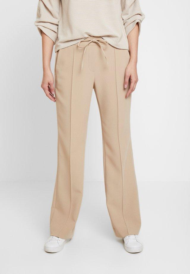 MONI - Trousers - soft ginger