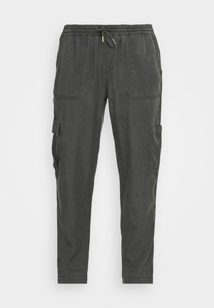 MUNDINI - Trousers - oliv tree