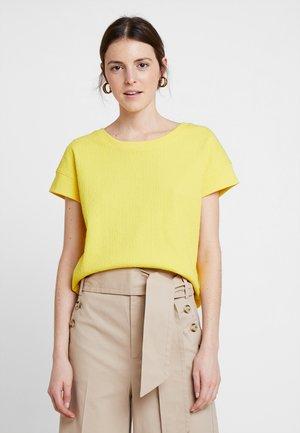 GUNDALA - T-shirt print - mellow yellow