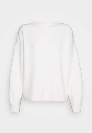 POLDINE - Pullover - milk