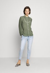 Opus - LETTY - Relaxed fit jeans - light blue washed - 1
