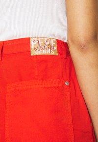 Pepe Jeans - DUA LIPA x PEPE JEANS - Spodnie materiałowe - bright orange - 6