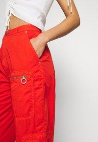 Pepe Jeans - DUA LIPA x PEPE JEANS - Spodnie materiałowe - bright orange - 3