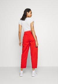 Pepe Jeans - DUA LIPA x PEPE JEANS - Spodnie materiałowe - bright orange - 2
