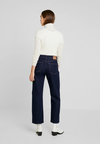 Pepe Jeans - IVORY - Flared Jeans - denim archive rinsed - 2