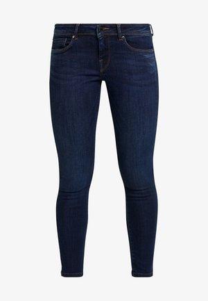 LOLA - Jeans Skinny Fit - denim dark used powerflex