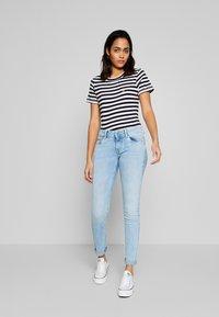 Pepe Jeans - KATHA - Slim fit jeans - light-blue denim - 1