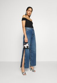 Pepe Jeans - DUA LIPA x PEPE JEANS - Flared Jeans - dark blue denim - 1