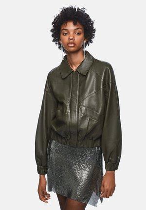 DUA LIPA - Leather jacket - dark khaki green