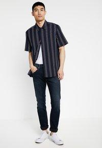 Pepe Jeans - TRACK - Straight leg jeans - black used gymdigo - 1