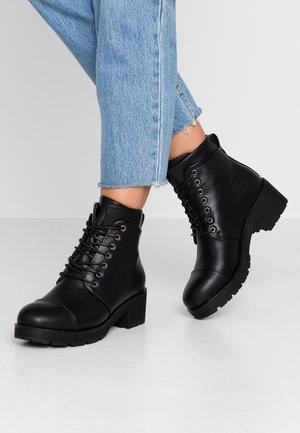 PSDAKOTA BOOT - Ankle boots - black