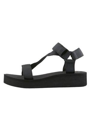 RIEMEN - Sandaalit nilkkaremmillä - black