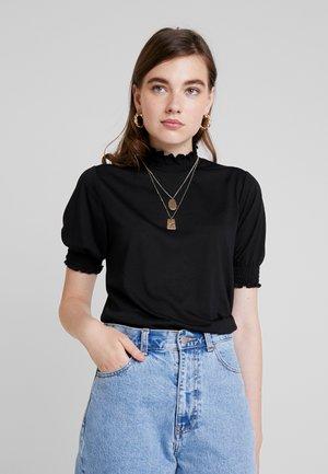 PCLANA SMOCK KEY - T-shirt z nadrukiem - black
