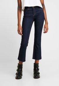 Pieces - PCDELLY KICK FLARED RAW HEM - Jeans a zampa - dark blue denim - 0