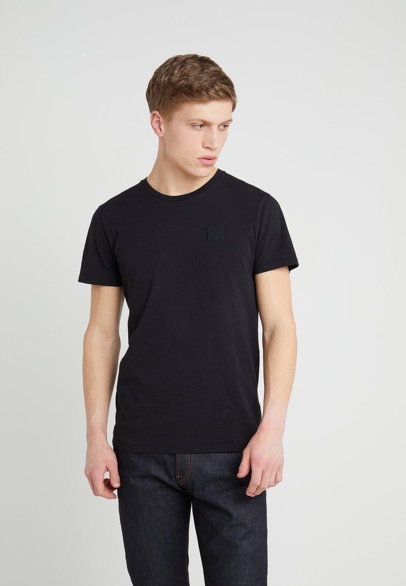Peak Performance Urban - URBAN TEE - T-Shirt basic - black