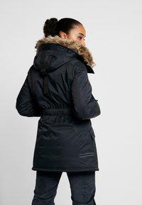 Peak Performance - LOCAL  - Zimní kabát - black - 2